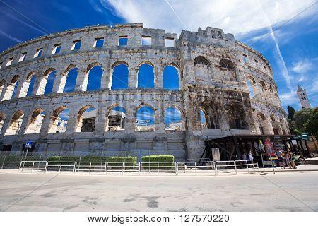 PULA, CROATIA - August 30, 2014 - Ancient Roman Amphitheater and Church in Pula, Istria, Croatia