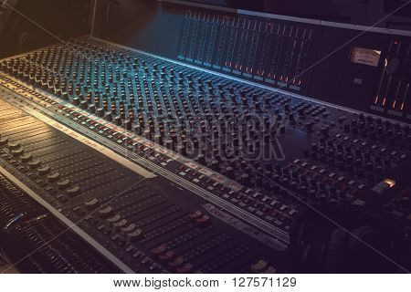 Sound recording equipment. Music mixer controls. Soft photo
