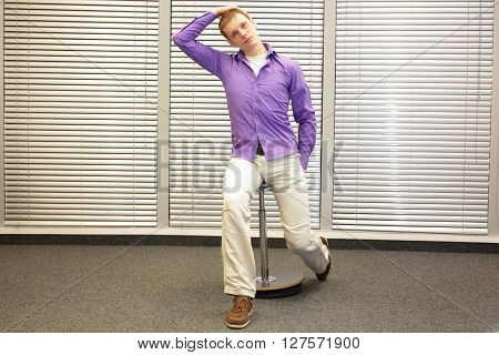 white collar worker male relaxing neck - short break for exercise in office