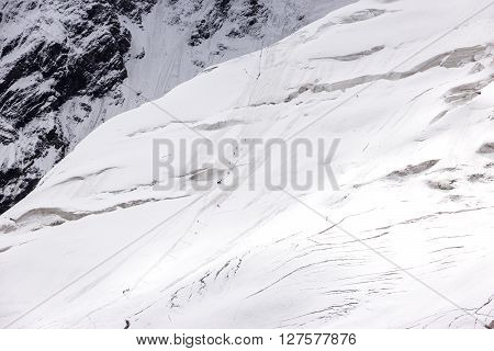 Glacier with Many Dangerous Crevasses Many Small People Bodies Ascending Snowbound Trail