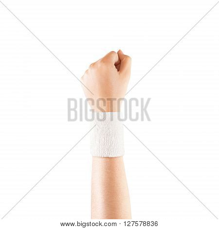 Blank white wristband mockup on hand, isolated. Clear sweat band mock up design. Sport sweatband template wear on wrist arm. Sports support protective bandage wrap. Bangle on the tennis player hand.