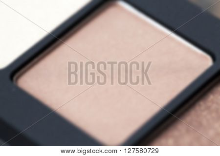 photographed close-up eye shadows, women's cosmetics, disfocus