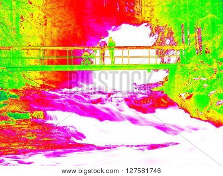 Foamy Water Of Waterfall, Bellow Footpath Bridge With People. Cold Water Of Mountain River In Infrar