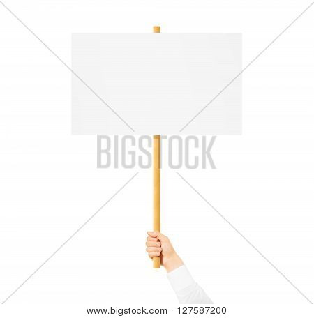 Hand holding blank banner mock up on wood stick isolated. Empty board plank hold in hands. Holding sign up. Clear signal stick. Man person holding placard signal. Protesters people on picket strike.