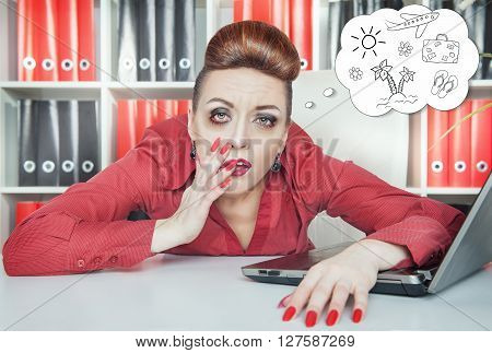 Tired Bored Businesswoman Dreaming About Holiday In Office