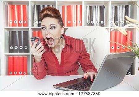 Angry Screaming Business Woman With Telephone
