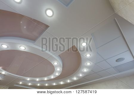 Modern layered ceiling with embedded lights and stretched ceiling inlay lights on