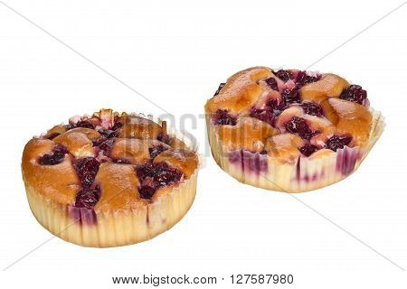Small cake with cherry fruits isolated on white background.