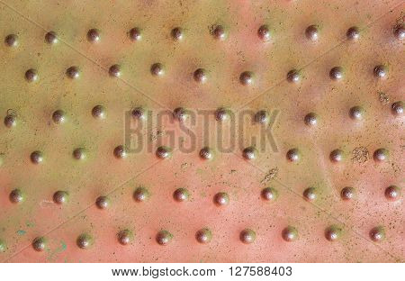 old painted iron plate with tubercles red texture