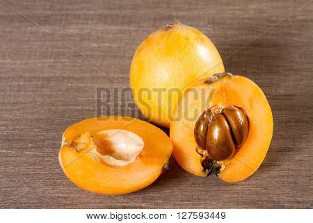 loquats on wooden background