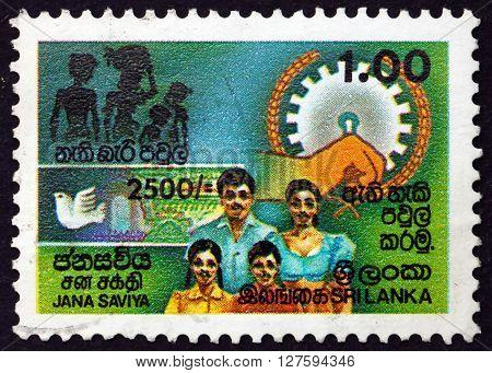 SRI LANKA - CIRCA 1990: a stamp printed in Sri Lanka shows Family Jana Saviya Grants Development Program to Eliminate Poverty and Improve the Standard of Living circa 1990