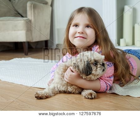 happy girl with her dog at home
