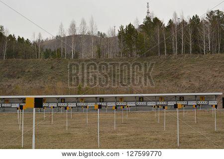 Krasnoyarsk - April 26: Biathlon shooting range field in the spring. Dinamo ski stadium on April 26, 2016 in Krasnoyarsk, Siberia, Russia.