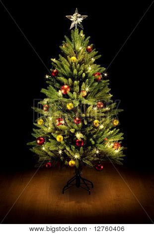 Christmas Tree and Gifts. Over black background