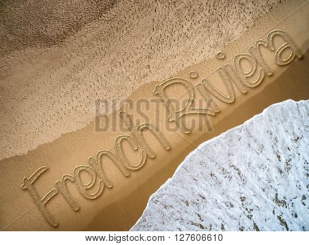 French Riviera written on the beach