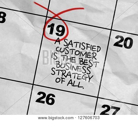 Concept image of a Calendar with the text: A Satisfied Customer Is The Best Business Strategy Of All