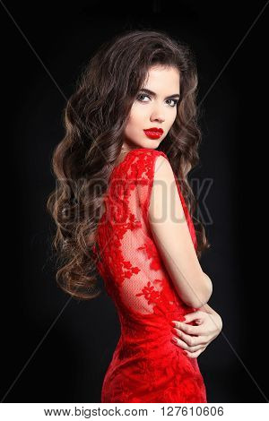 Beauty Fashion Portrait. Beautiful Brunette Woman With Curly Hairstyle And Makeup, Wearing In Red La