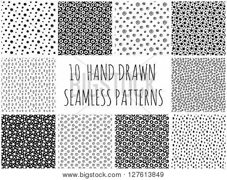 Abstract polka dot pattern set with hand drawn dots. Cute vector black and white polka dot pattern set. Seamless monochrome polka dot pattern set for fabric, wallpapers, cards and web backgrounds.