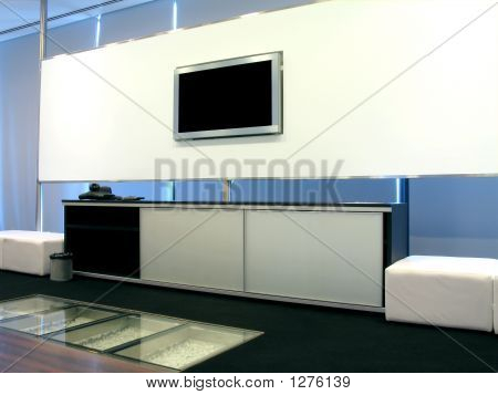 a modern-looking office meeting room with lcd screen whiteboard and video conference equipment. poster