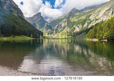 Stunning View Of Seealpsee (lake) And The Alpstein Massif
