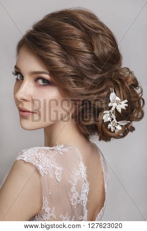 Beautiful bride with fashion wedding hairstyle - on white background.Closeup portrait of young gorgeous bride. Wedding. Studio shot. Beautiful bride portrait
