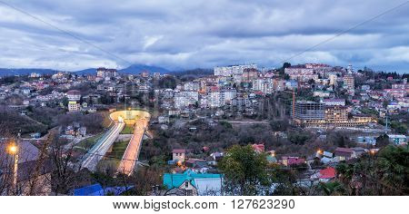 The city of Sochi, view residential houses and automotiv tonnel. Russia poster