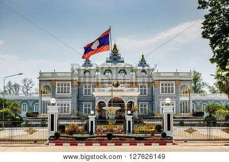 Ho Kham Presidential Palace with Laotian flag in capital of Laos, Vientiane