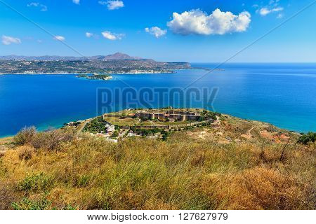 View on sea bay and old venitian fortress in Aptera on Crete island, Grecee