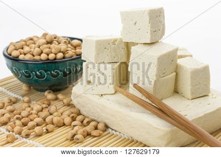 Tofu Block And Cut Cubes With Soybeans,  On White Background.