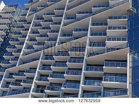 Exterior details of a modern luxury condominium building in miami beach,florida