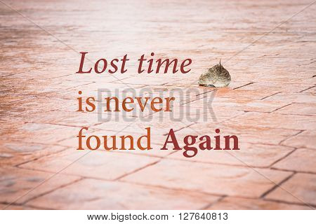 Lost time is never found again. Inspirational quote stock photo