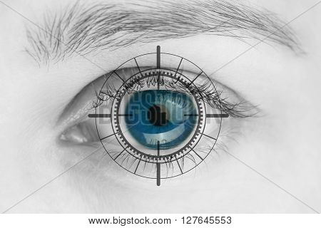 Scanner on blue human eye - black and white photo