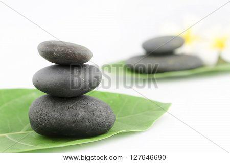 Balanced black zen stones on white background