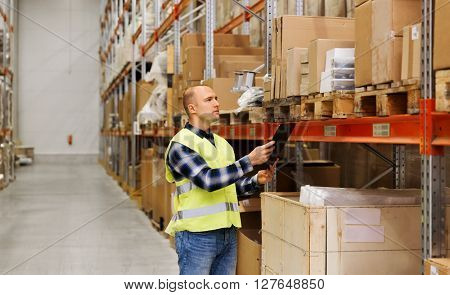 wholesale, logistic, people and export concept - man with clipboard in reflective safety vest at warehouse