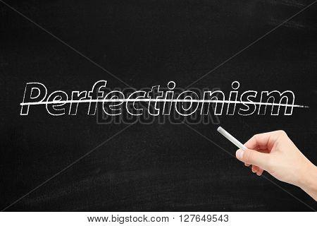 Perfectionism written on a blackboard