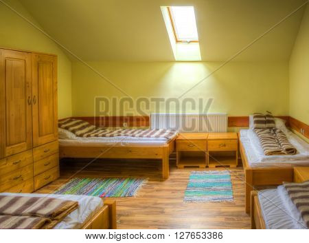 Clean hostel room with beds and wardrobe