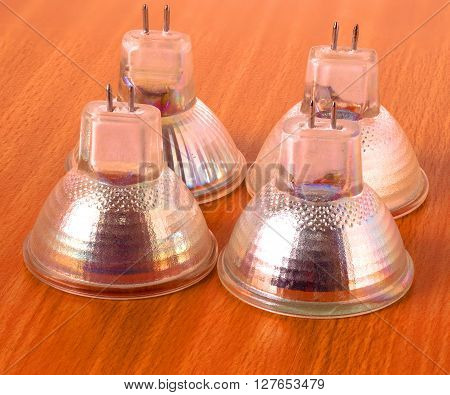modern halogen light bulbs on a wooden table