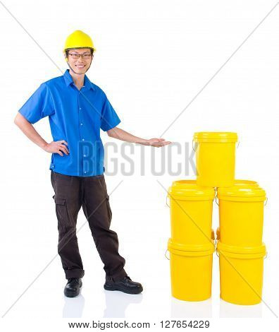 Lubricant oils and greases distributor with suit hardhat pointing his hand over the products thumb-up isolated on white background.