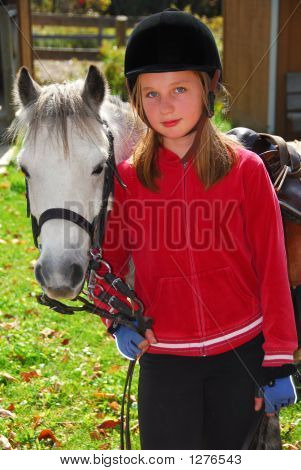 portrait of a young girl with a white pony poster