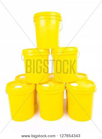 Yellow plastic bucket with yelllow lid. Product Packaging for lubricant oil.Isolated over white background. poster