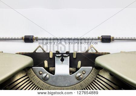 Close-up of words Erectile dysfunction on typewriter sheet