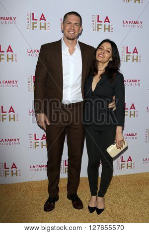 LOS ANGELES - APR 21:  Steve Howey, Sarah Shahi at the LA Family Housing Awards at the The Lot on April 21, 2016 in Los Angeles, CA