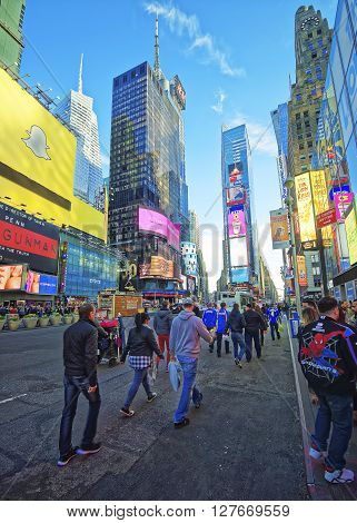 Pedestrians On Broadway And 7Th Avenue In Times Square