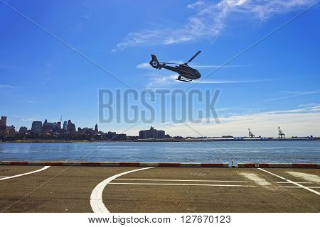 Black Helicopter Over Helipad In Lower Manhattan