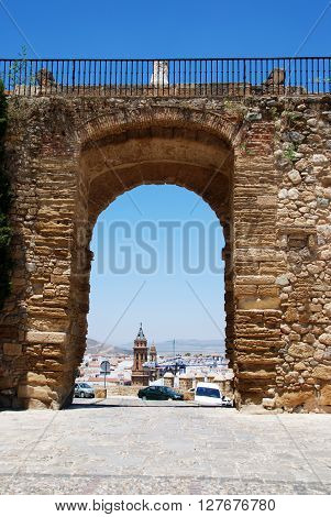 ANTEQUERA, SPAIN - JULY 1, 2008 - View through the giants arch (Arco de los Gigantes) towards the town buildings Antequera Malaga Province Andalucia Spain Western Europe, July 1, 2008.