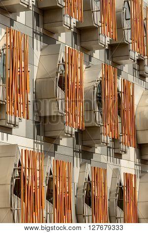 EDINBURGH SCOTLAND - APRIL 27 2016: The MSP's building of the Scottish Parliament in Holyrood Park Edinburgh. This building has distinctive bay windows with concrete