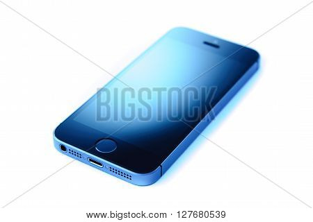 PARIS FRANCE - APR 21 2016: Beautiful studio shot if the new Apple iPhone SE combining the updated processor 4K rear camera touch id retina display
