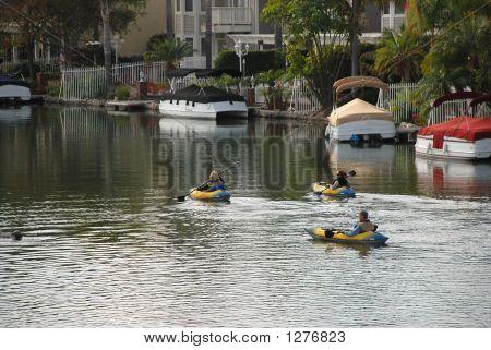 3 Kayakers On The Lake