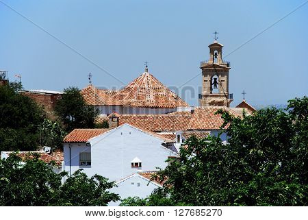 View over town rooftops towards a church Antequera Malaga Province Andalucia Spain Western Europe.