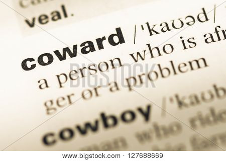 Close Up Of Old English Dictionary Page With Word Coward.
